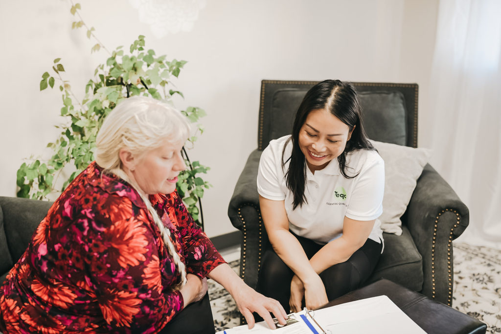 An EQC caregiver reviewing a custom plan with a client